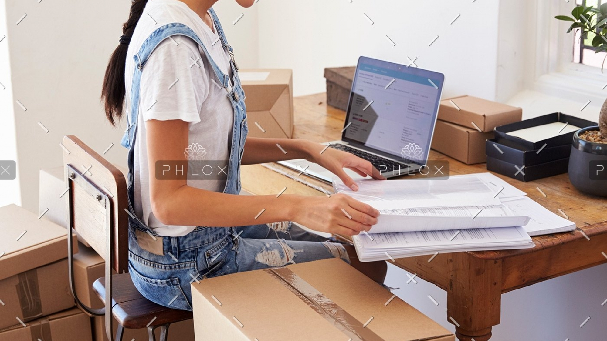 demo-attachment-139-woman-running-business-from-home-working-on-PCZKTN9