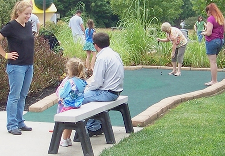 People Playing Miniature Golf